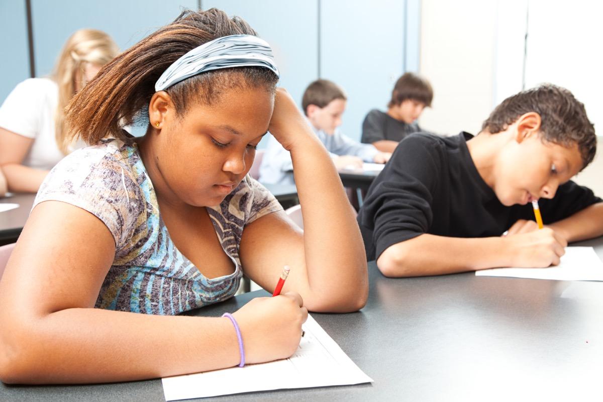 two kids taking test