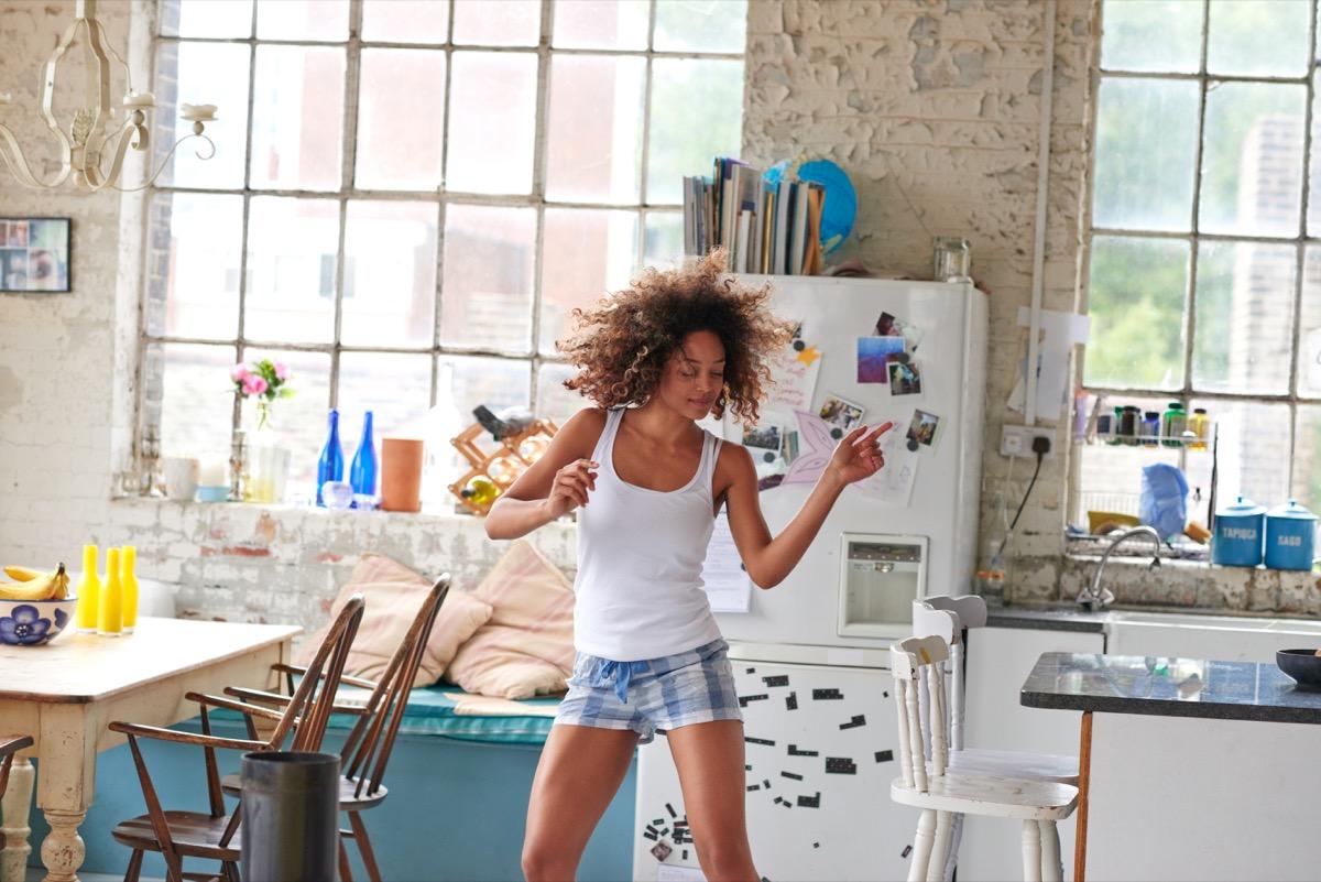 Girl dancing in her kitchen