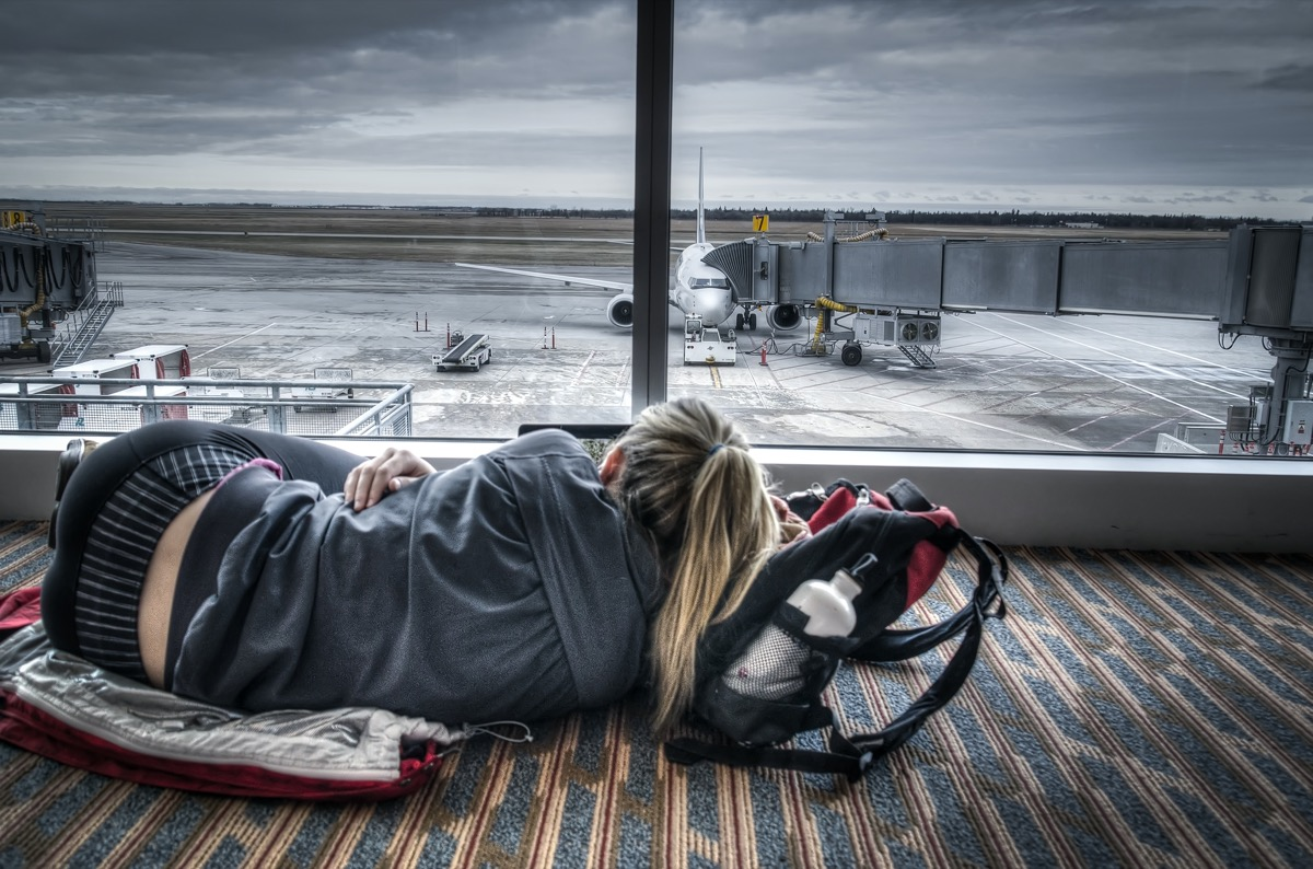 woman tired from layovers
