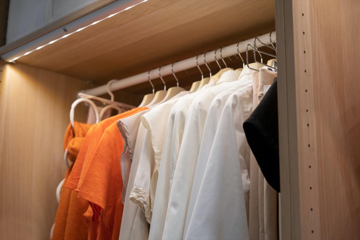 organized closet with led strip lighting