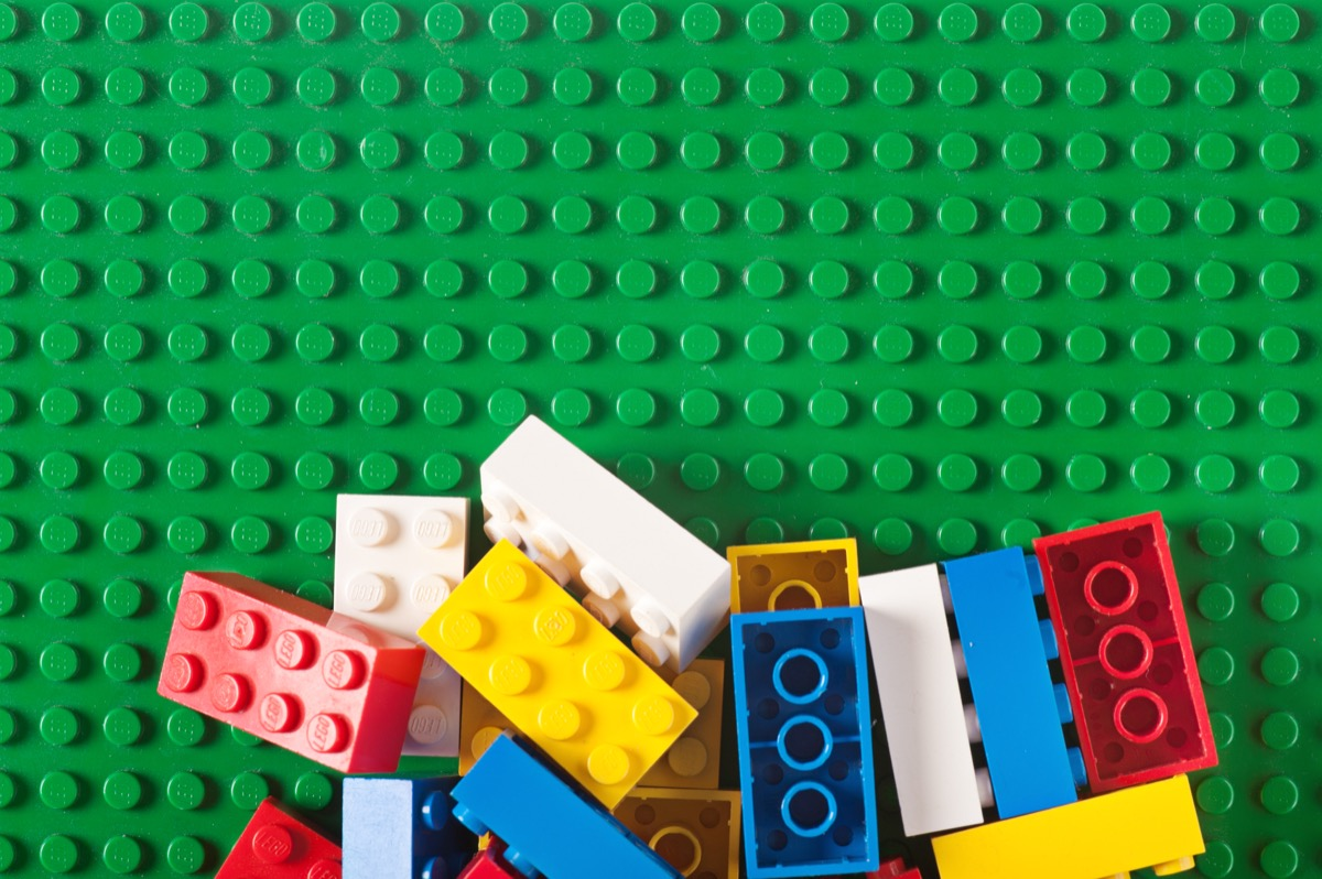 Albuquerque, USA - December 5, 2011: Colorful, old lego bloks on a pile. Studio shot. Lego, consists of colorful interlocking plastic bricks and an accompanying array of gears, minifigures and various other parts. Lego bricks can be assembled and connected in many ways, to construct such objects as vehicles, buildings, and even working robots. Anything constructed can then be taken apart again, and the pieces used to make other objects. The toys were originally designed in the 1940s in Denmark and have achieved an international appeal.