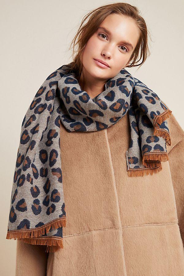 white woman wearing leopard scarf