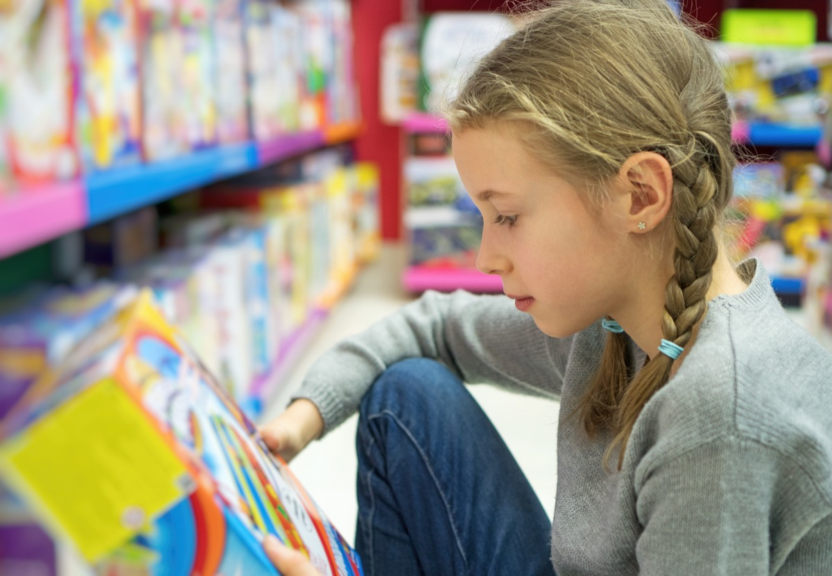 little girl shopping at toy store