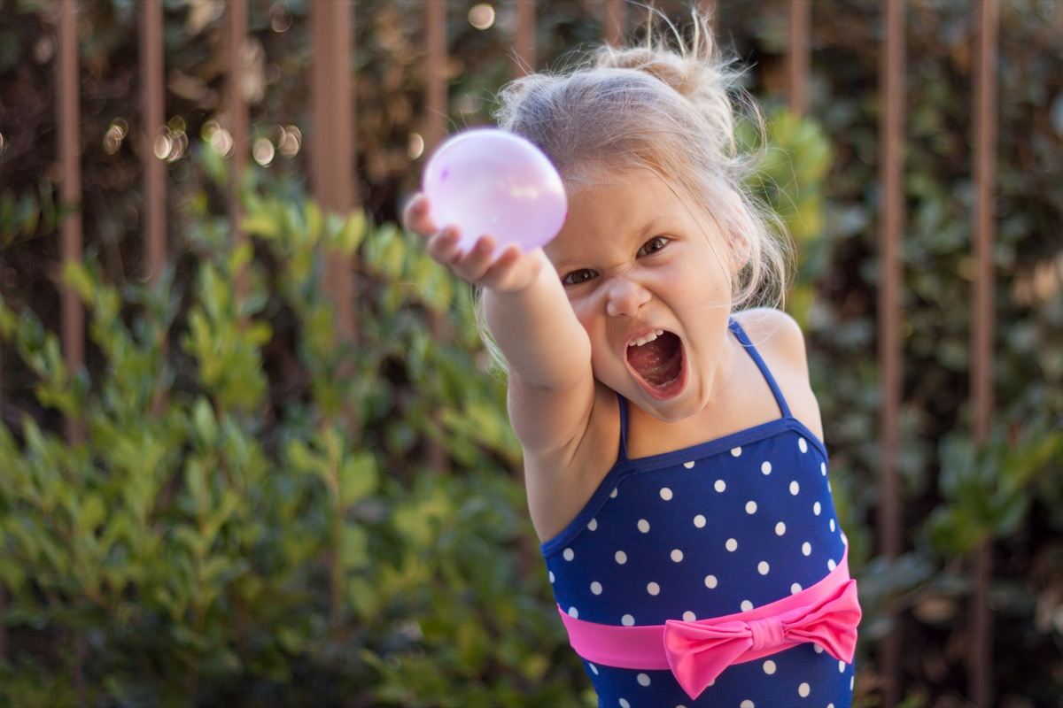 Little girl preparing for a water balloon fight