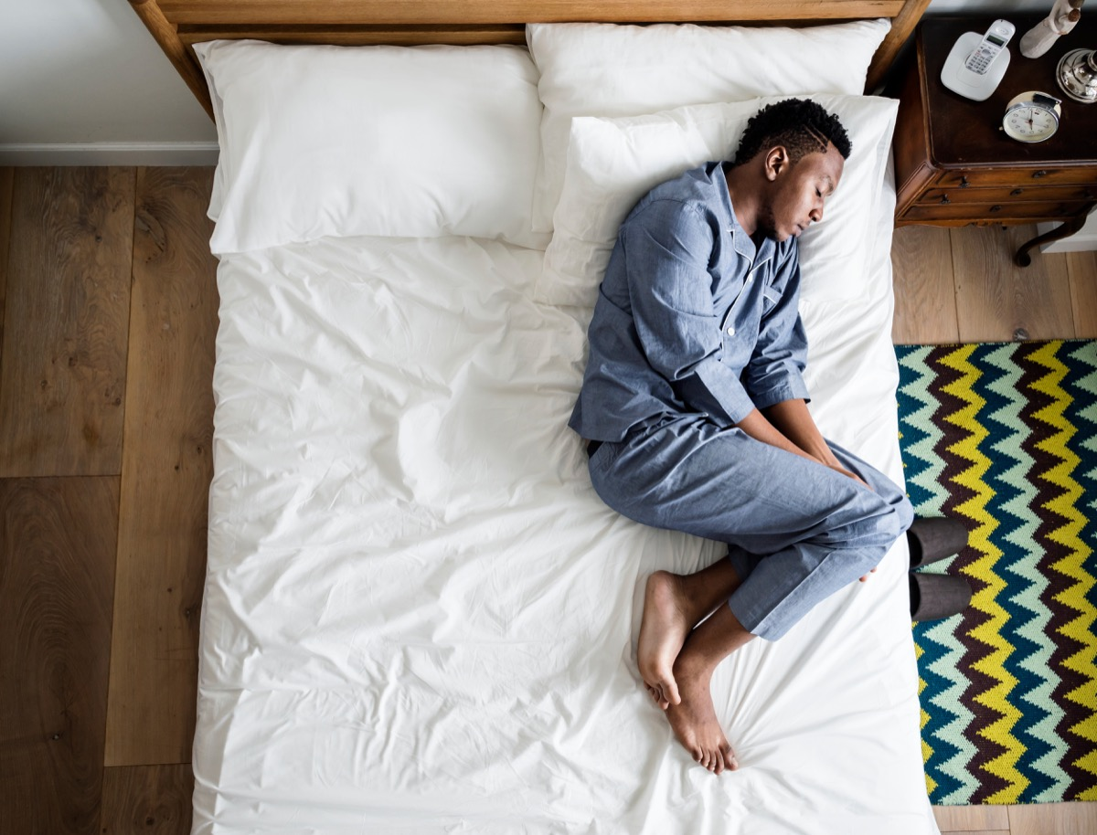 lonely man sleeping on the bed