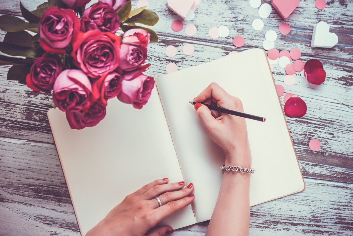 Woman writing a love letter