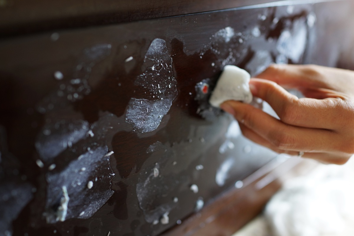 white hand cleaning ceramic cooktop with magic eraser