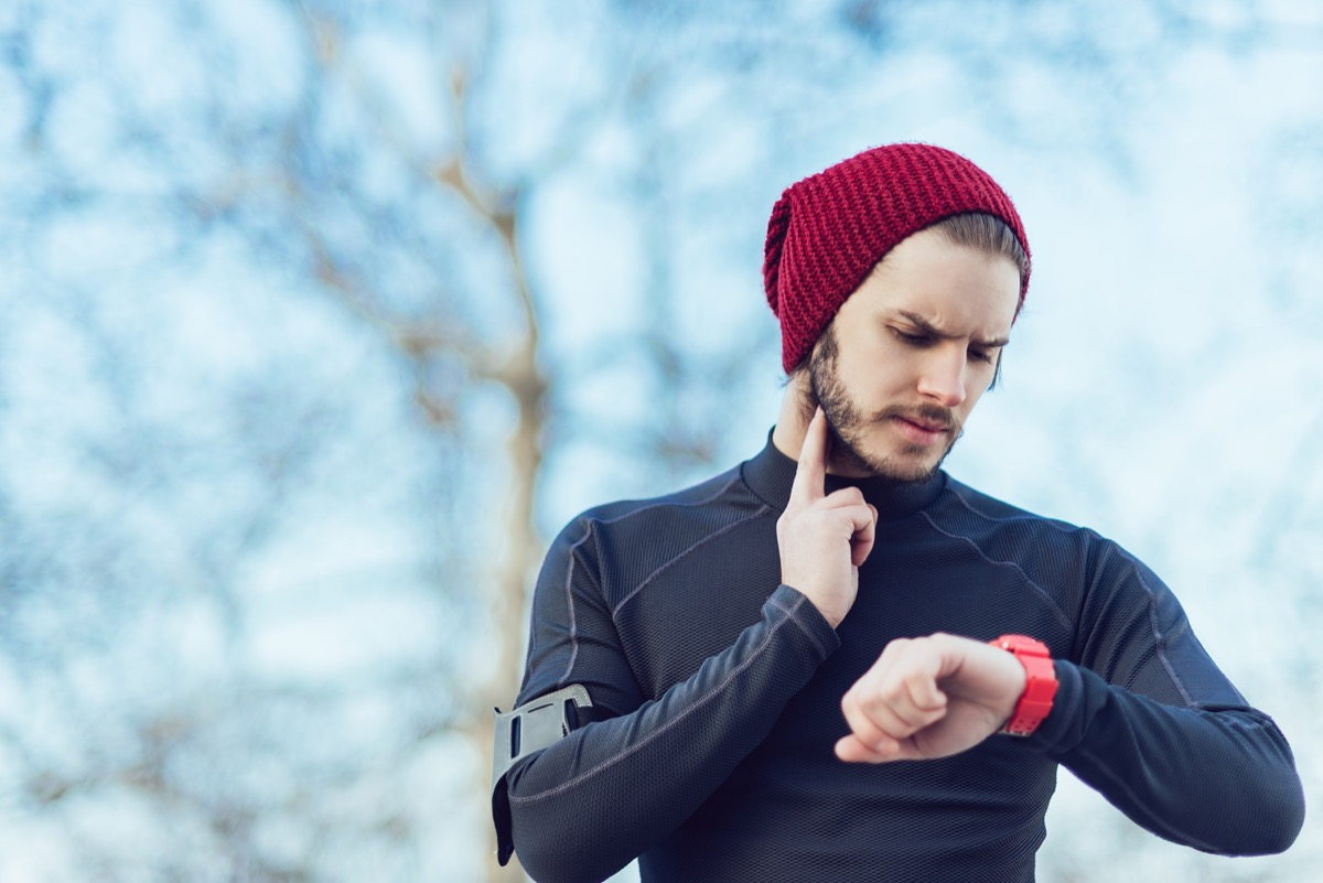 Man checking his heartbeat or heart rate