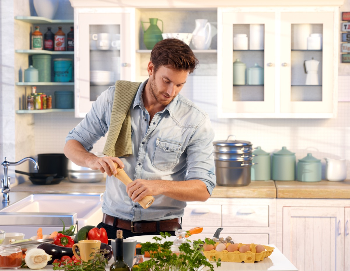 Young man preparing a home cooked meal in the kitchen
