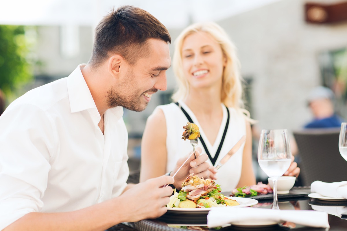 Man and woman eating healthy salad for lunch