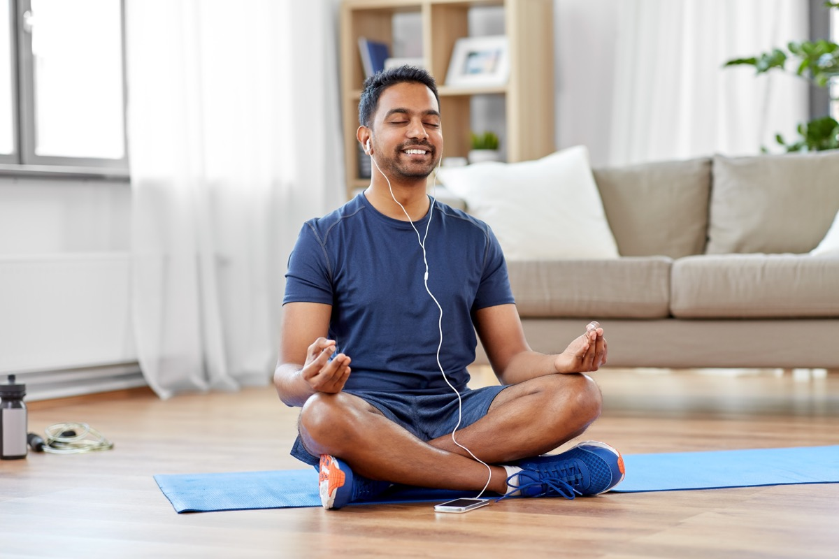Man meditating with earphones