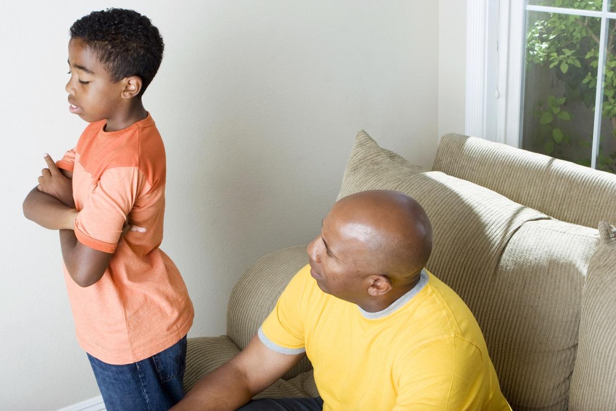 black man scolding grandson