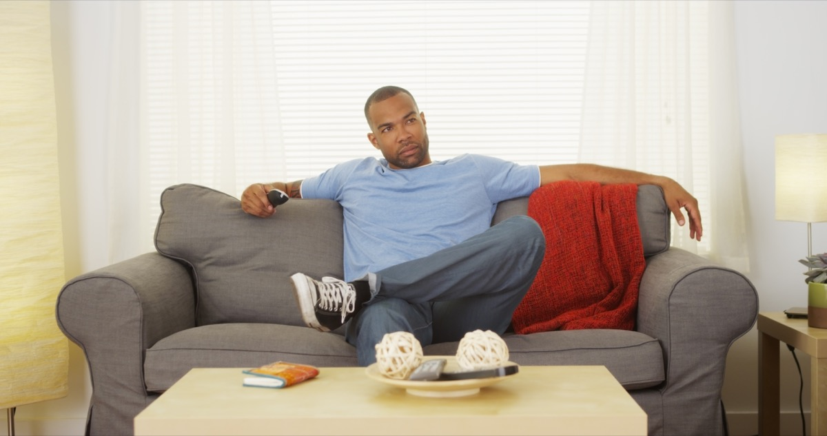 Man relaxing watching tv on his couch