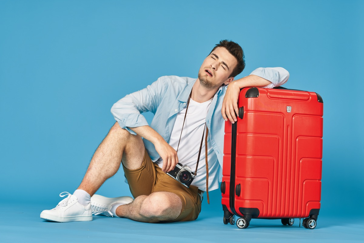 man sitting with his luggage