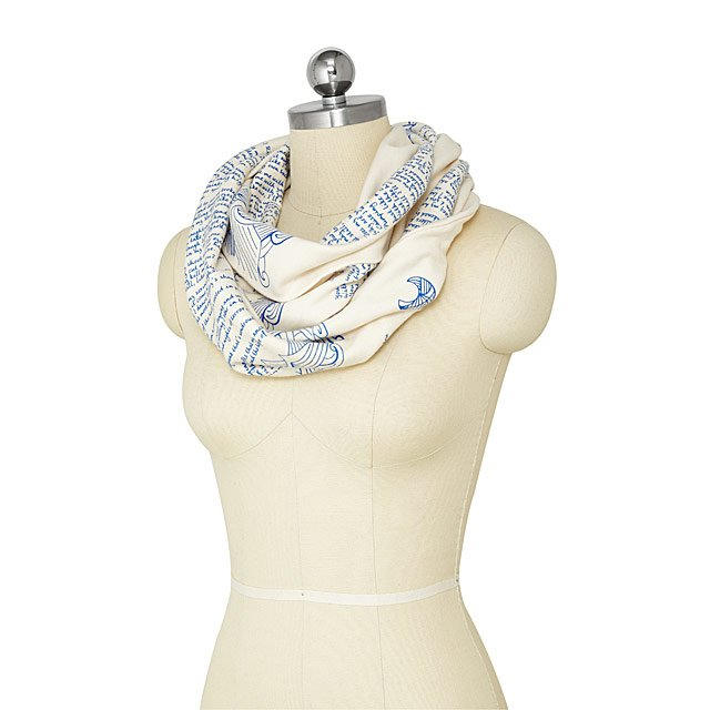 headless mannequin wearing blue and white Maya Angelou scarf