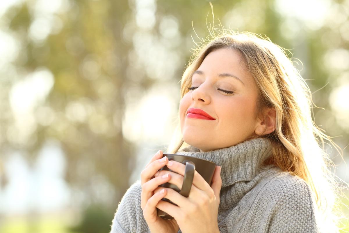 Mindful woman drinking tea