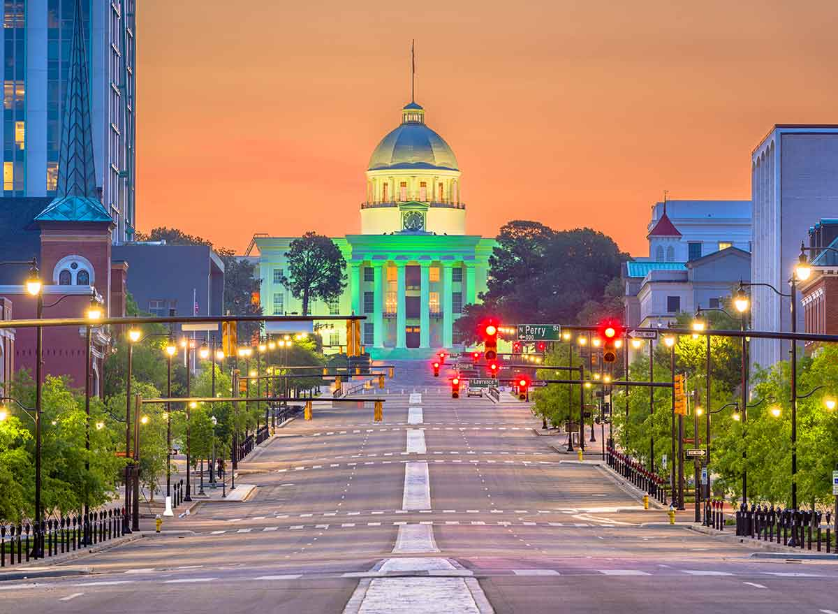 a street at dusk leading to the capitol building in montgomery