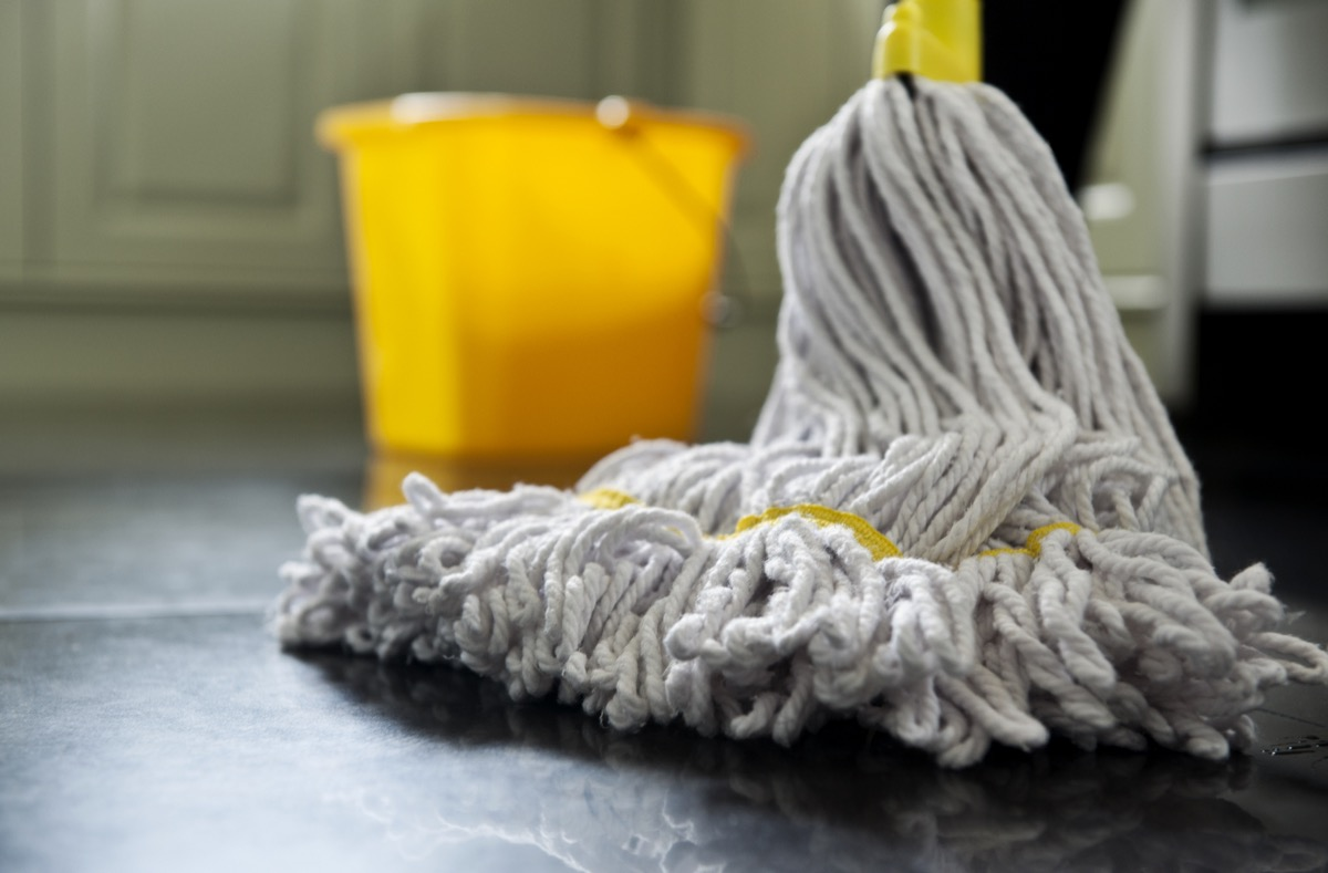 close up photograph of a mop and bucket with shallow depth of field