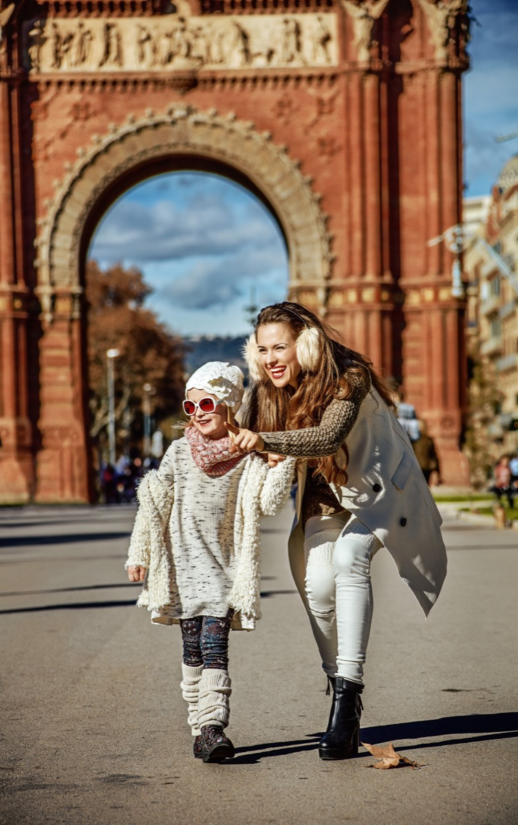 Mother and daughter sightseeing at the Arc de Triomphe