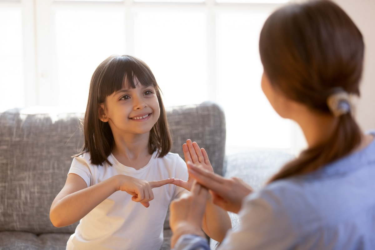 Mother and daughter learning sign language together