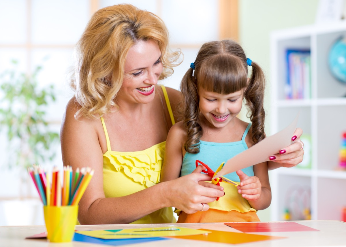 mother doing crafts with her daughter