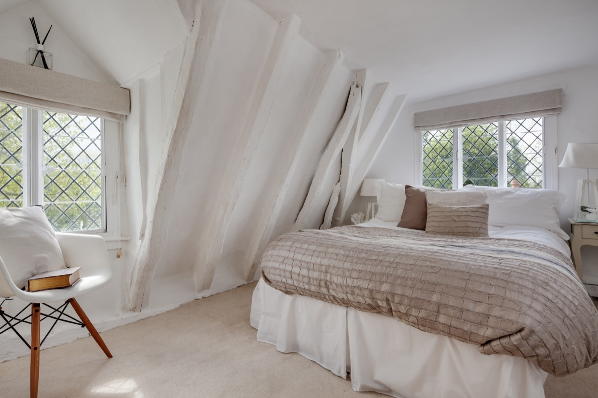 Master bedroom decorated in neutral colors like beige and white