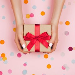 wrapped gift with red bowtie