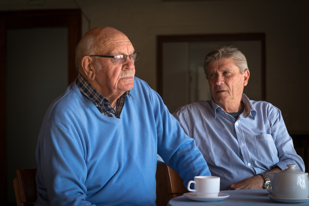 older boyfriends having a cup of coffee with an argument