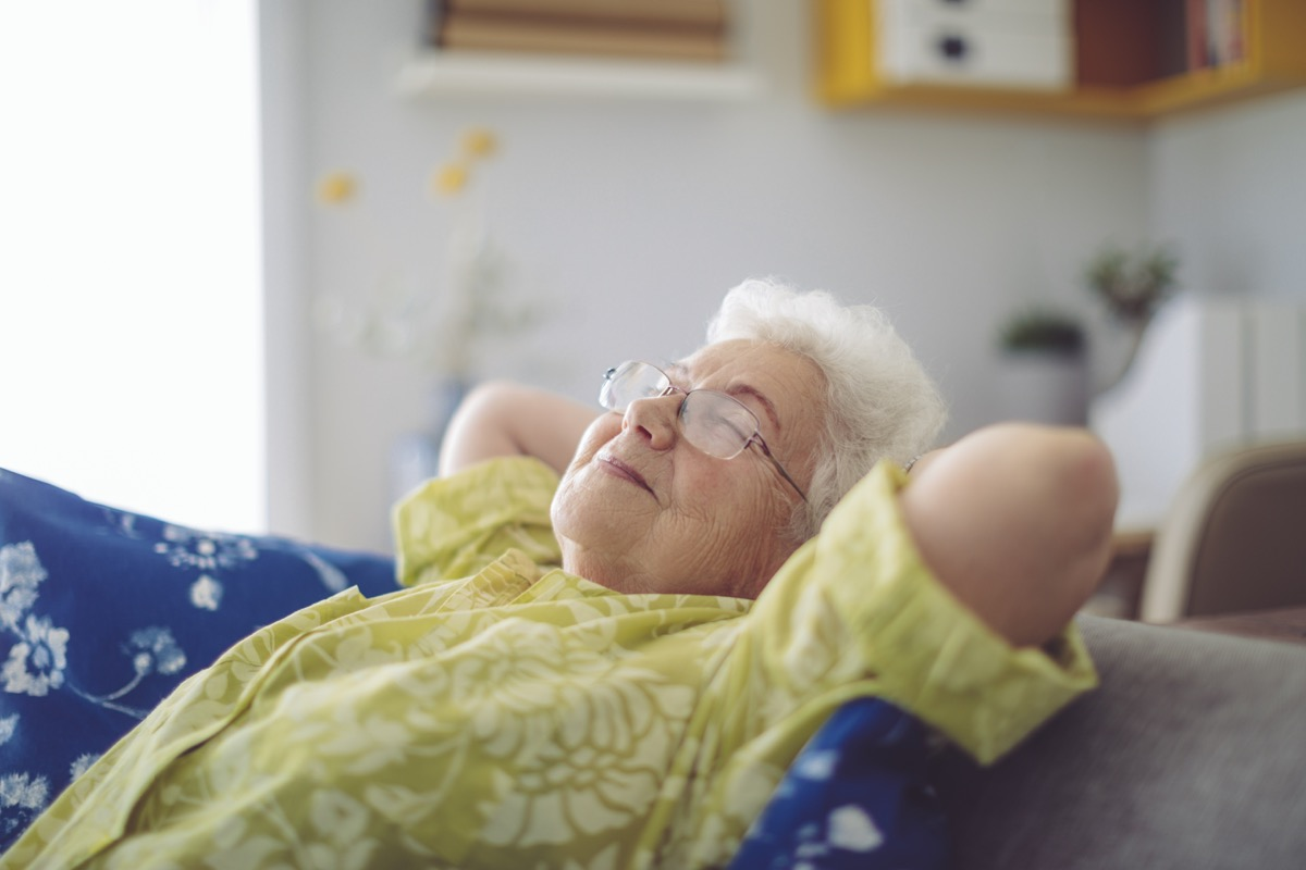 old woman relaxing in home