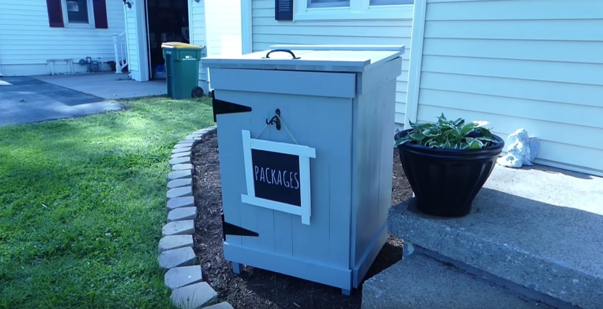 gray outdoor package mailbox with top handle