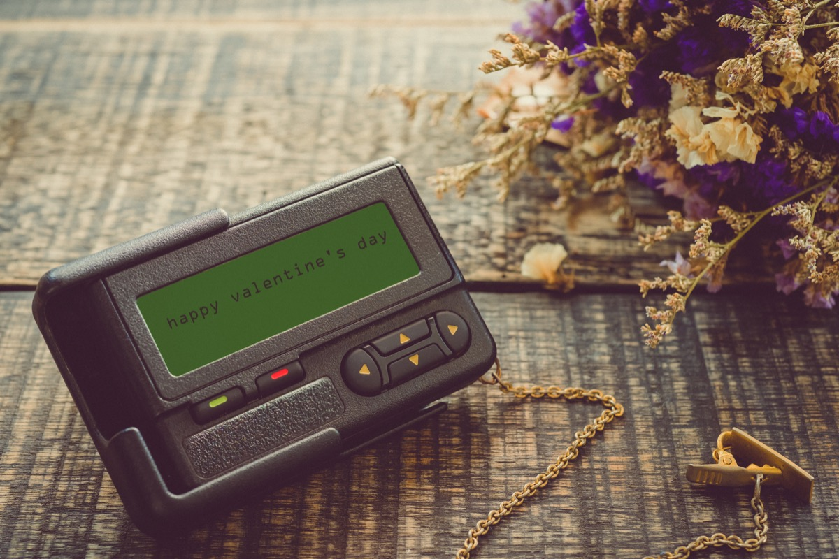 pager on a wooden table reading happy valentine's day