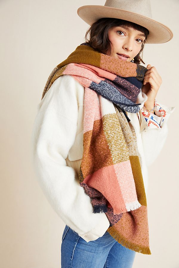 white woman wearing patchwork scarf