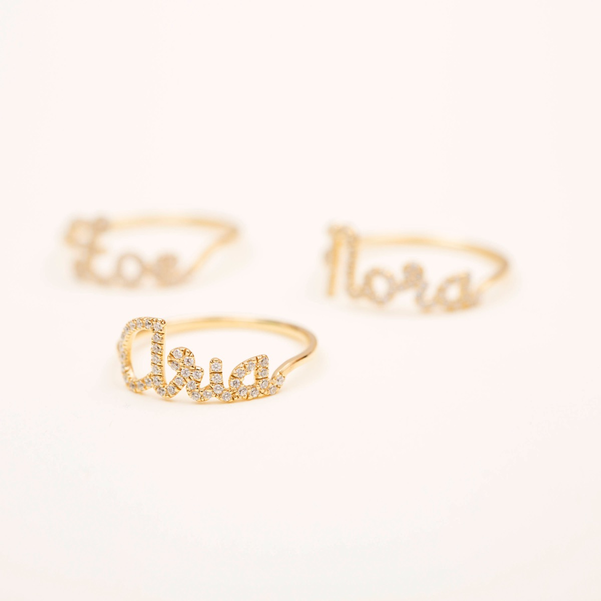 set of three gold name rings with CZ stones