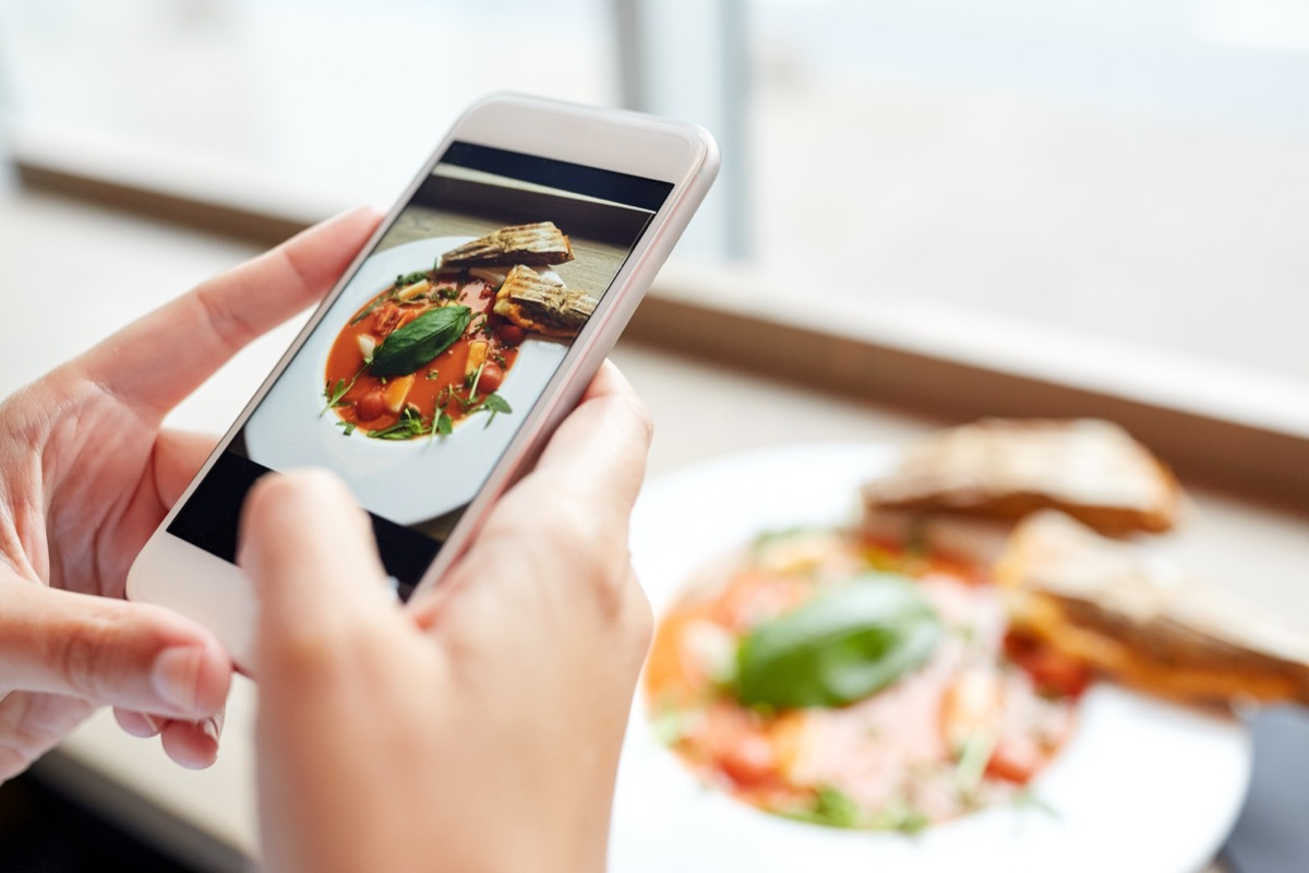 Person taking a picture of their food before eating