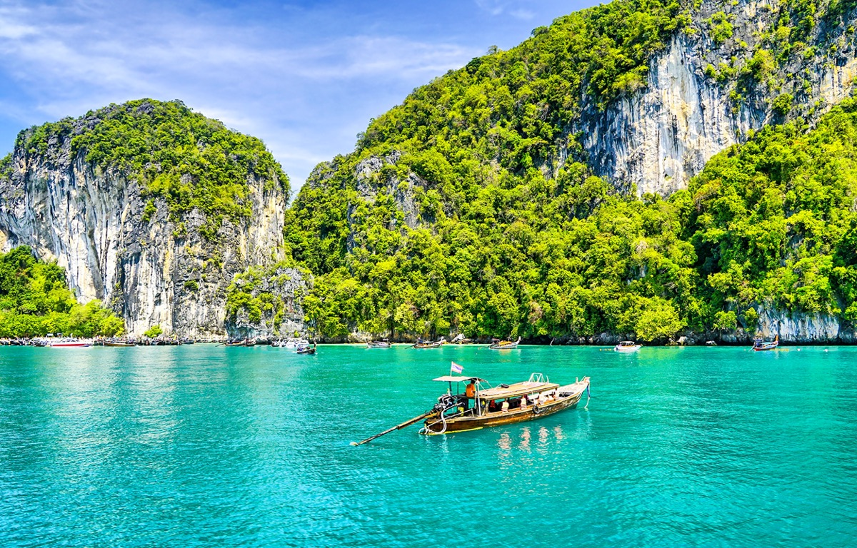 a boat by the island of phuket thailand