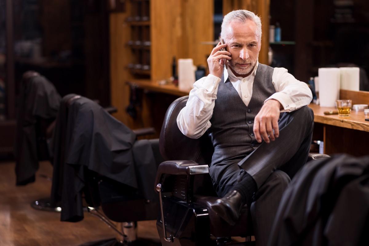 rich older white man on phone