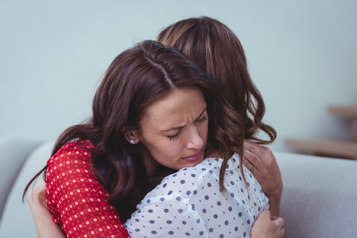 sad women hugging