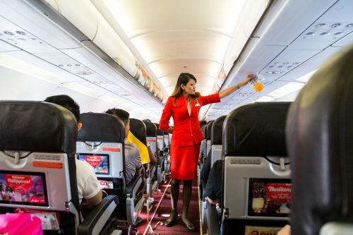 flight attendant doing the safety prep