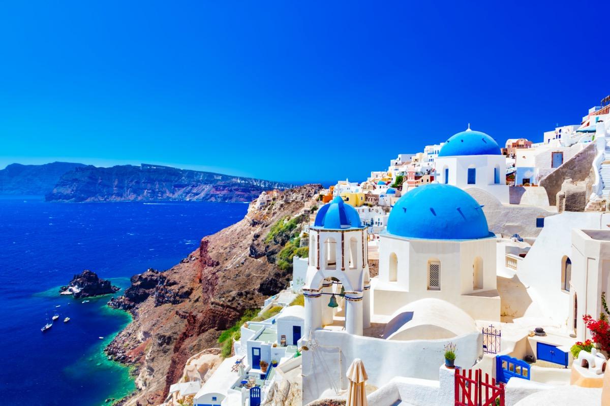 the famous blue-roof houses on santorini island greece