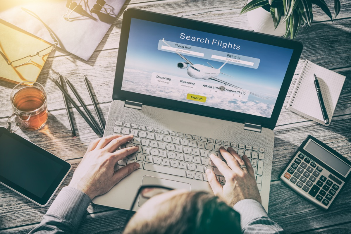 booking flights online on laptop