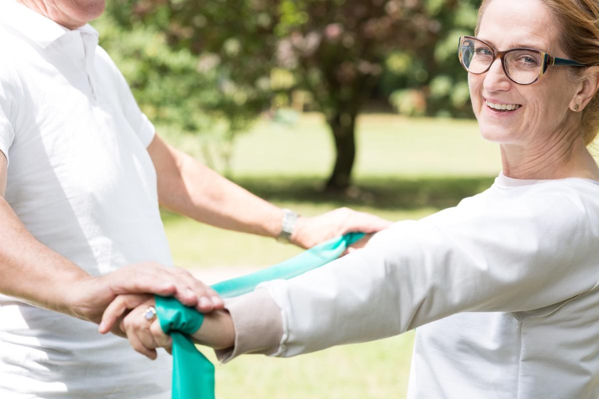 senior female exercising at the park