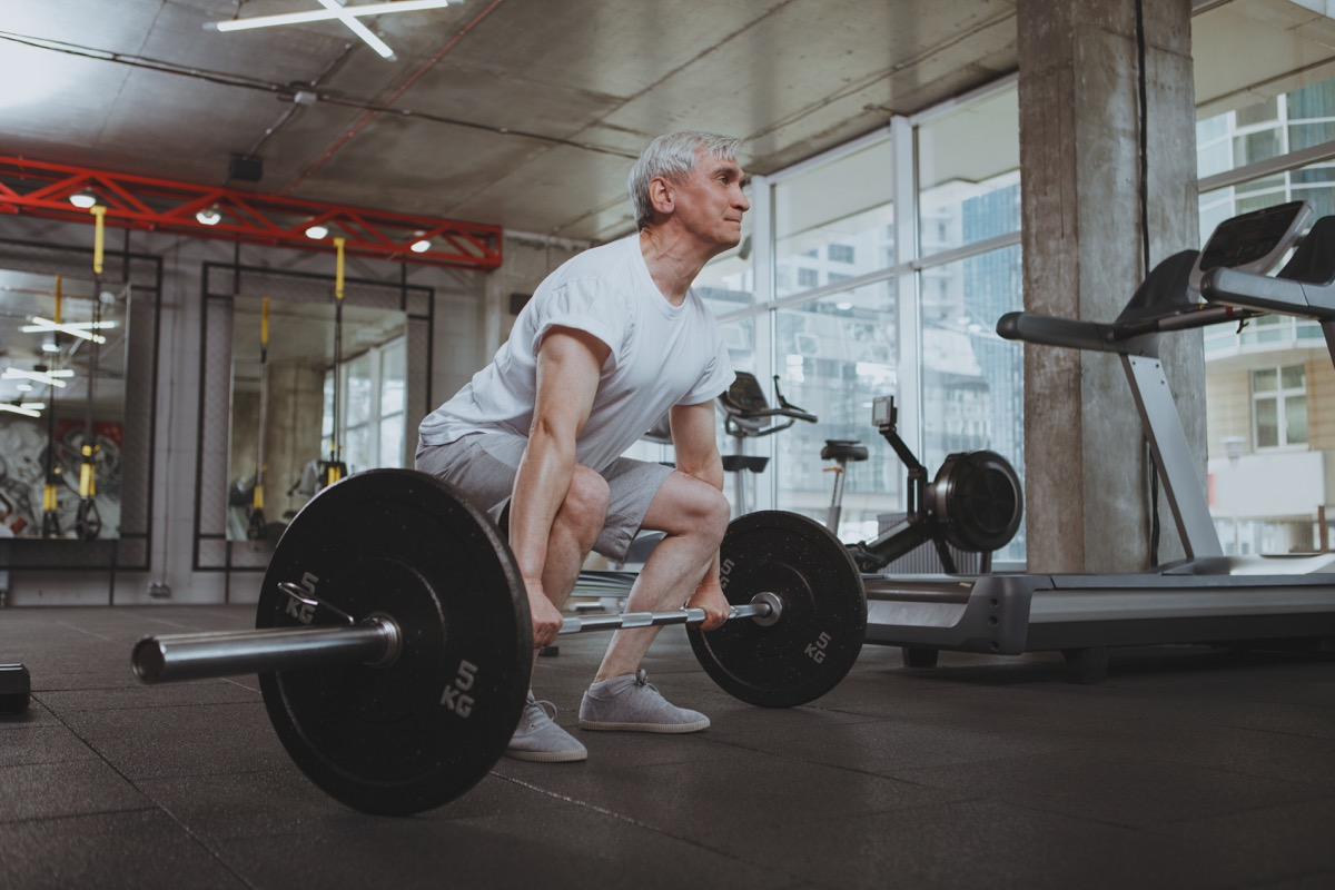 senior man doing deadlifts