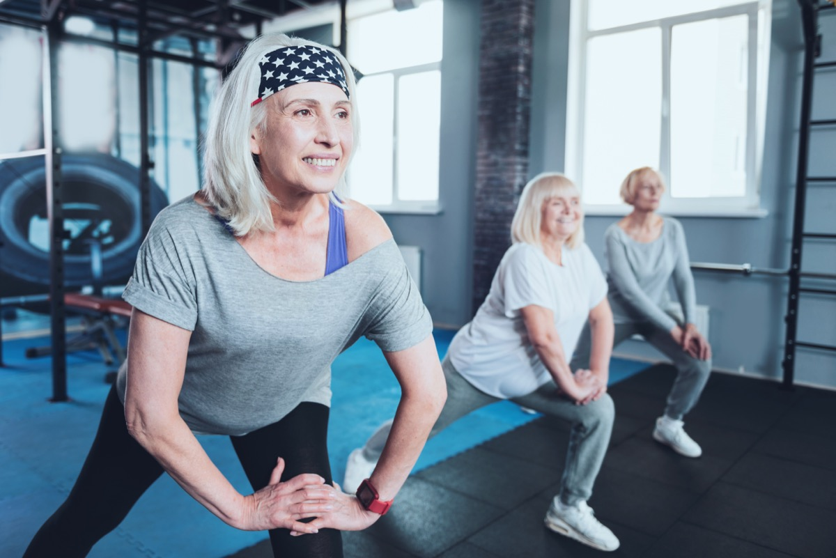 senior women doing lunges at the gym