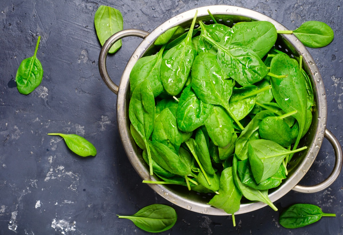 A bowl of freshly washed spinach leaves