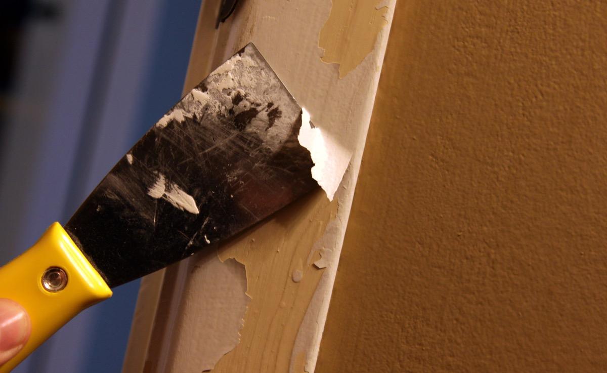 scraping paint off doorframe