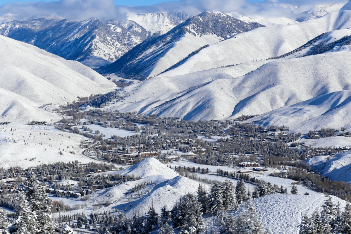 aerial view of sun valley resort in idaho in the winter with snowcapped mountains