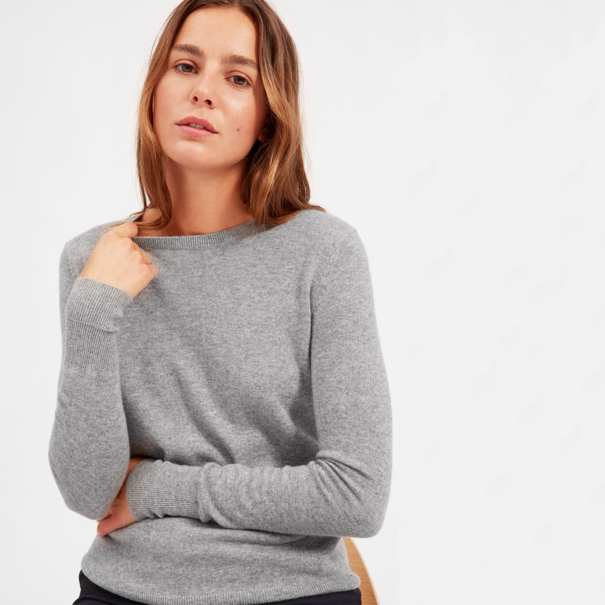 white woman in gray sweater