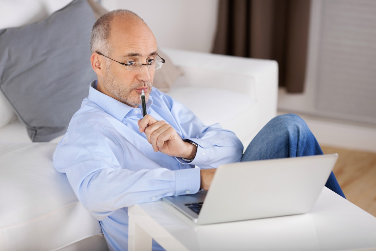thinking man on his laptop
