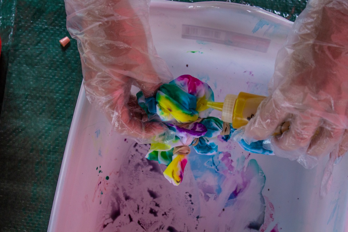 Person tie dying a tshirt