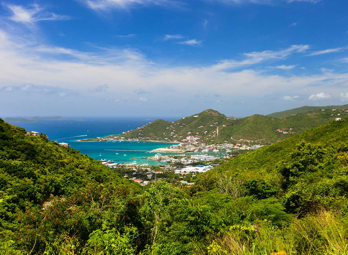 a panoramic view of the harbor and mountains in the british virgin islands